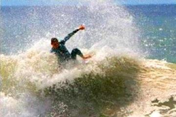Surfing in Puntarenas Playa Palo Seco