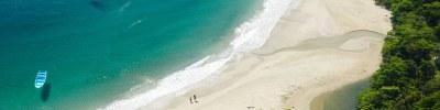 coiuple onm beachaerial